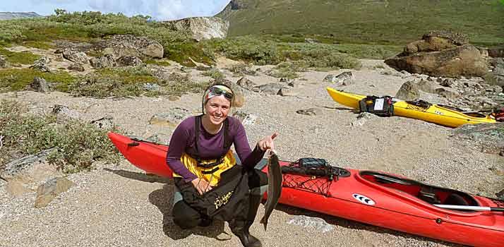 Kayaking and trekking Greenland. Tasermiut fjord fishing